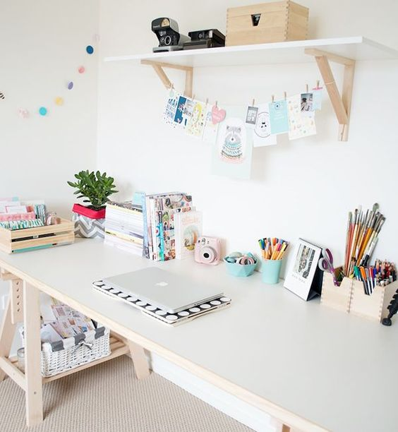 pastel creative space with an opne shelf and X leg desk