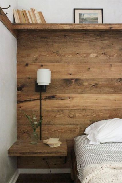 warm-stained accent wall with wall-mounted nightstands