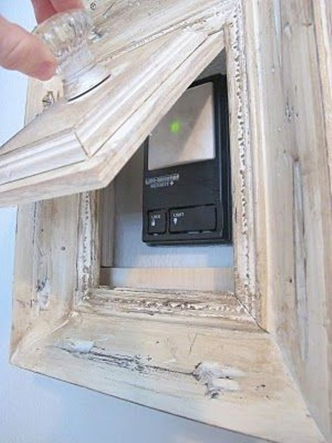 a picture frame that hides an alarm system