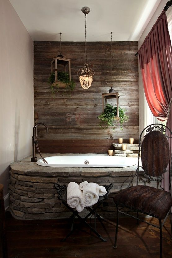 dark wood wall echoes with stone bathtub decor