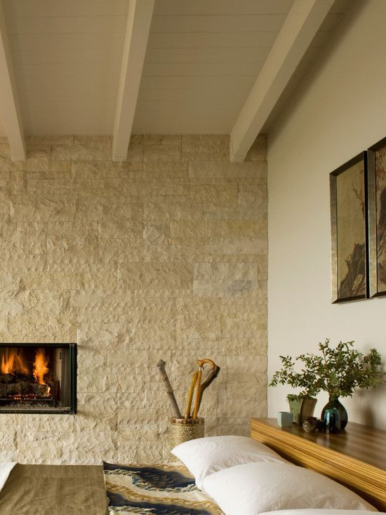 neutral bedroom decor with a textural fireplace wall