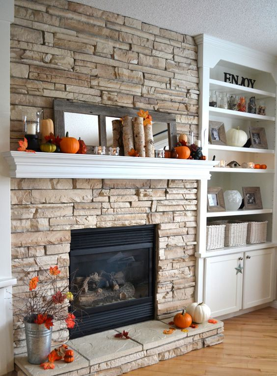 pumpkins, birch branches, faux leaves, modern candle holders and a mirror