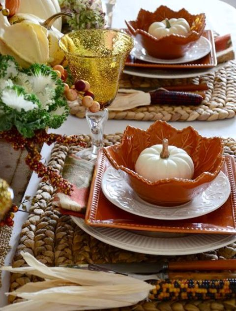 whimsy table setting with leaf-shaped chargers, woven mats and corn
