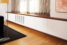 20 white and natural wood radiator cover attached to the window sill