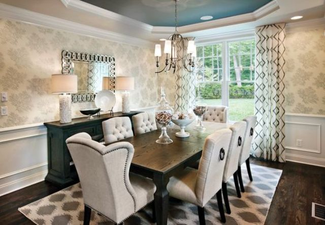 elegant dining space with patterned wallpapers and low wainscoting