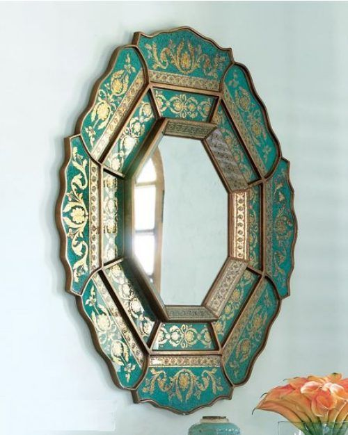 green and gold carved mirror frame