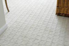 21 square-patterned white carpet floor for a bedroom