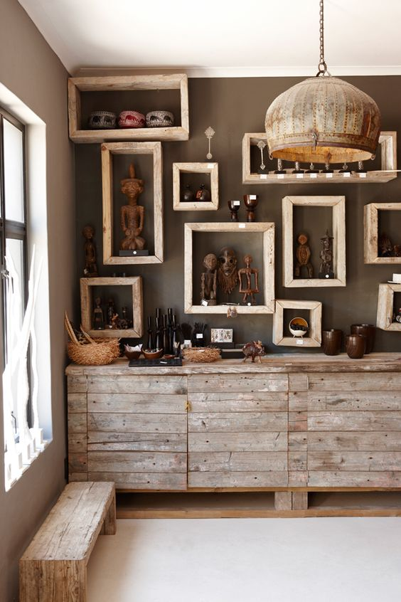 Namibian statuettes and pottery on framed shelves