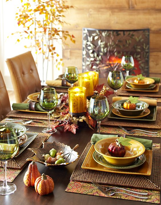 fall-colored tablescape in warm shades with faux pumpkins