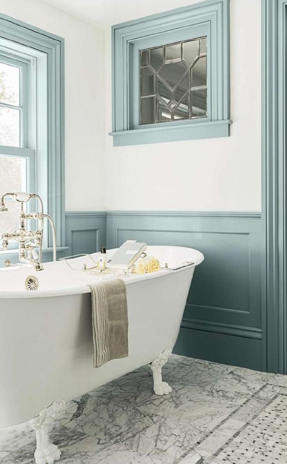 turquoise wainscoting echoes with frames