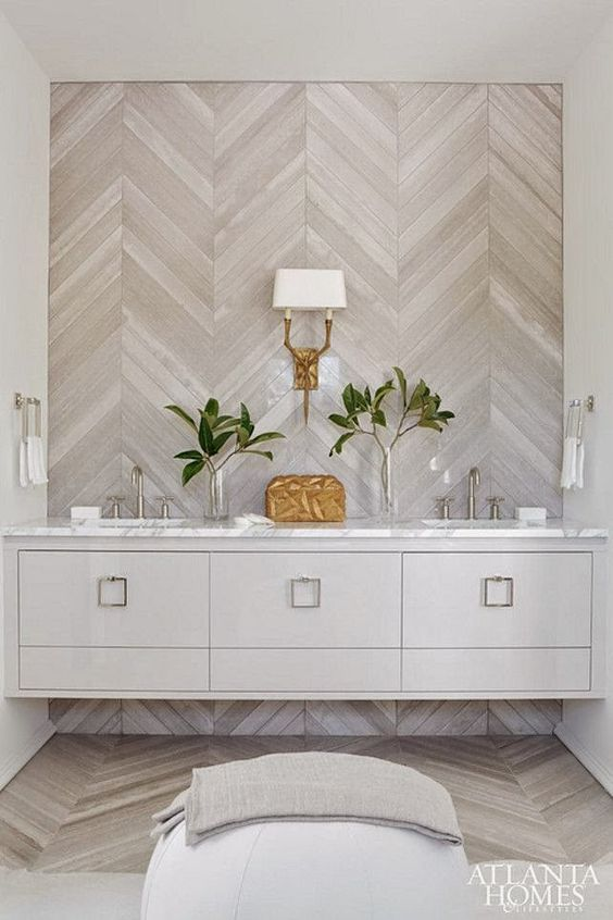wood is a hot decor trend for bathrooms, here it's a whitewashed diagonal wall
