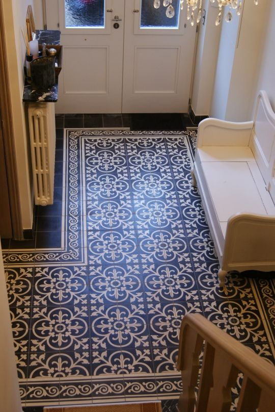 Portuguese tiles create an area rug look at the entryway