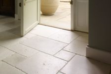 23 beautifully aged limestone floors in the entryway and outdoors to connect spaces