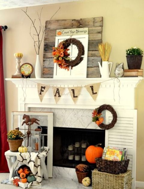 burlap bunting, wheat, fall wreath and a small pumpkin on a stand