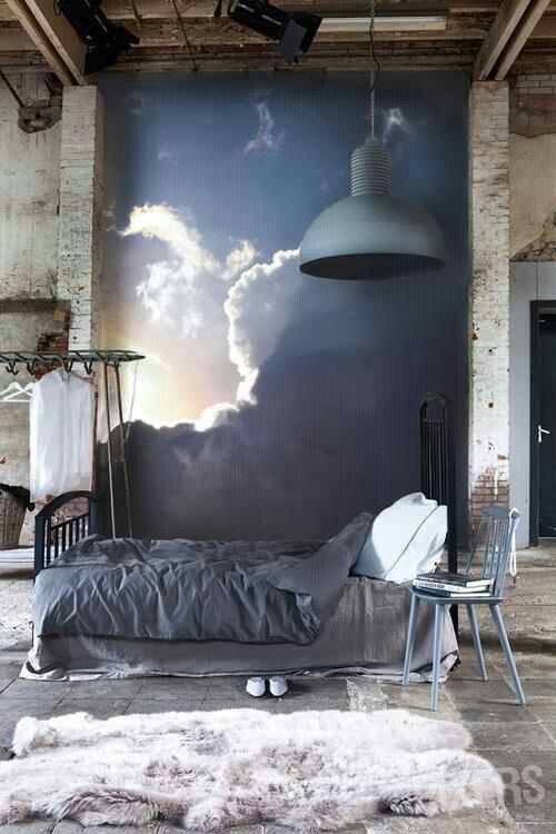 mural wall with the sun coming out of the clouds for a rough industrial bedroom