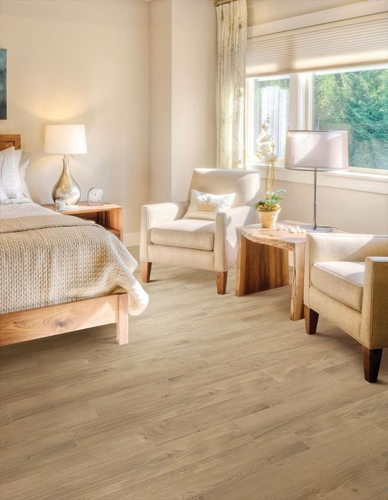 the floors complete the light colored look of this bedroom
