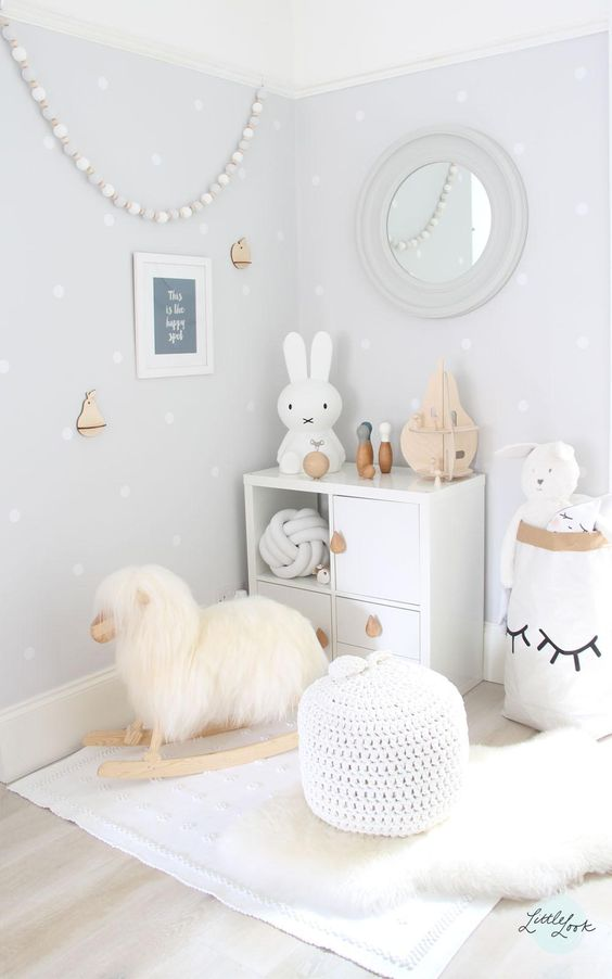 white play space with a sheep rocker and toys