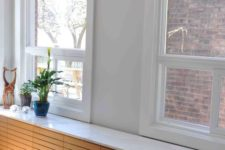 23 wooden radiator cover that serves as a window sill and a display shelf