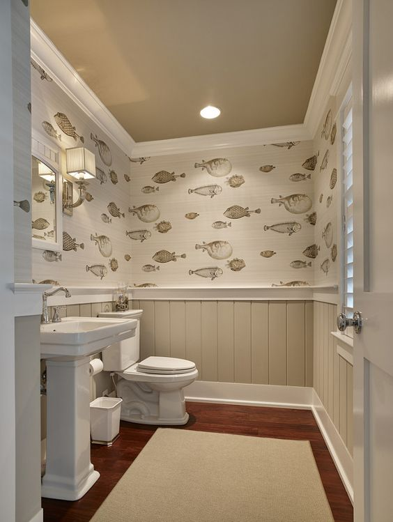Beige Wainscoting With Fish Patterned Wallpaper