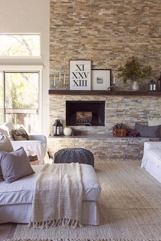 faux stone fireplace wall becomes a focal point in this cozy living room