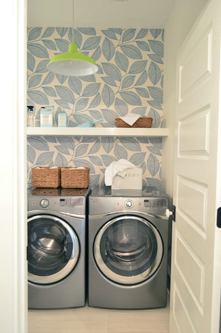 light patterned wallpaper accentuates the laundry and doesn't make it look small