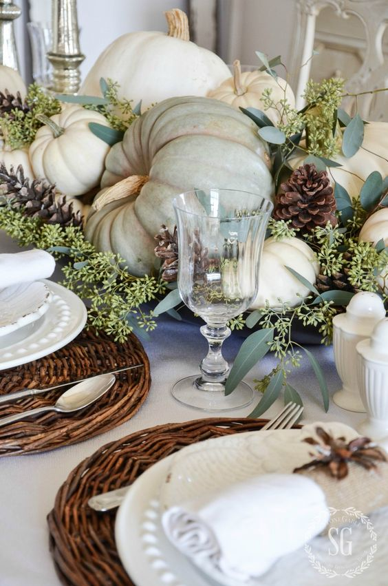 natural neutral-colored pumpkins and greenery for a centerpiece