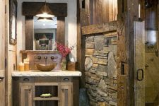 24 stone floors and rough stone walls for a cabin bathroom