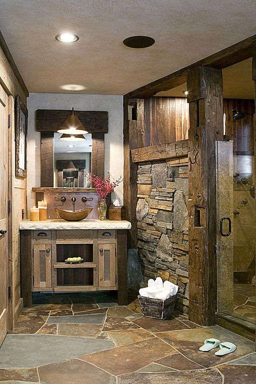 stone floors and rough stone walls for a cabin bathroom