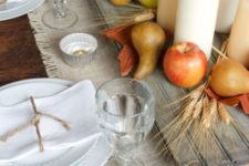 25 board with apples, pears and candles on a fabric table runner