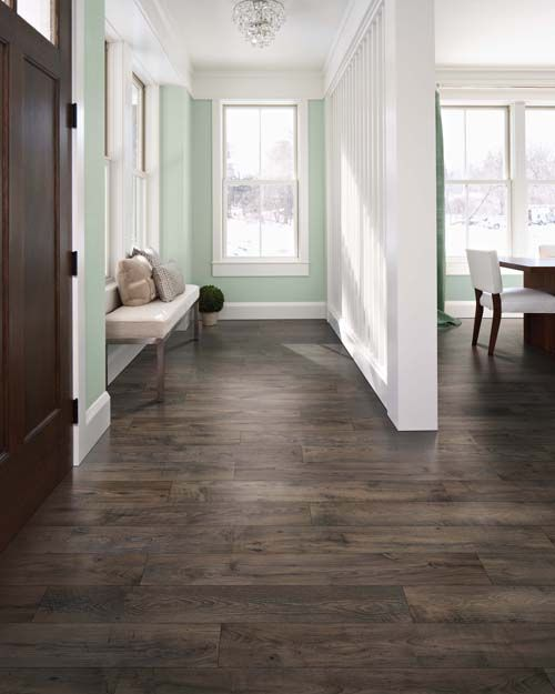dark hardwood floors create a contrast with mint green walls