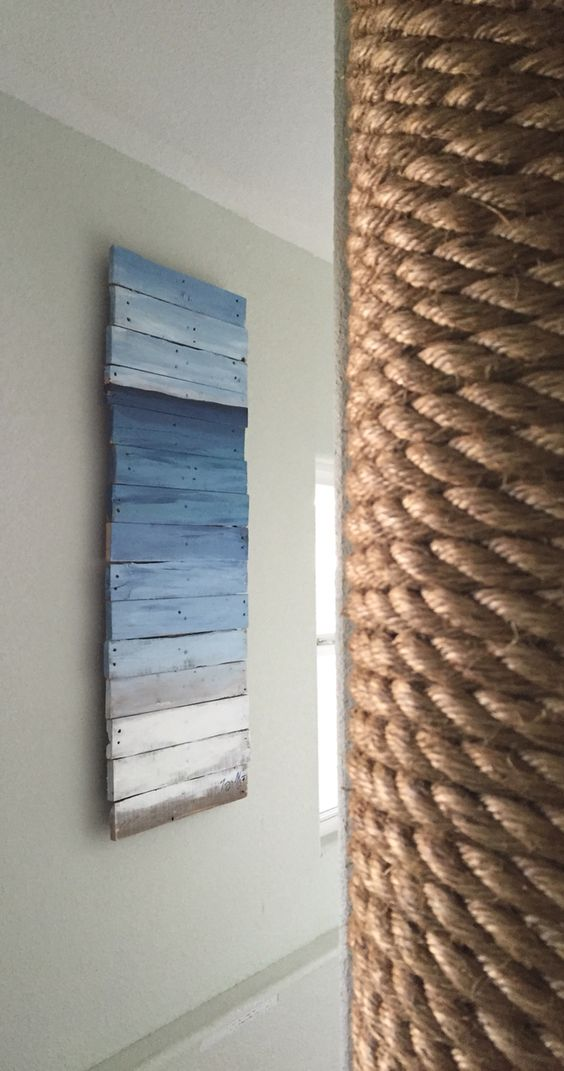 ombre ocean inspired pallet wall art to cover an electrical box