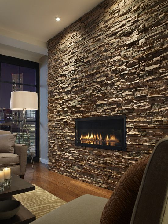 Dark Stacked Slate With The Inset Fireplace And Well Placed Accent Lighting