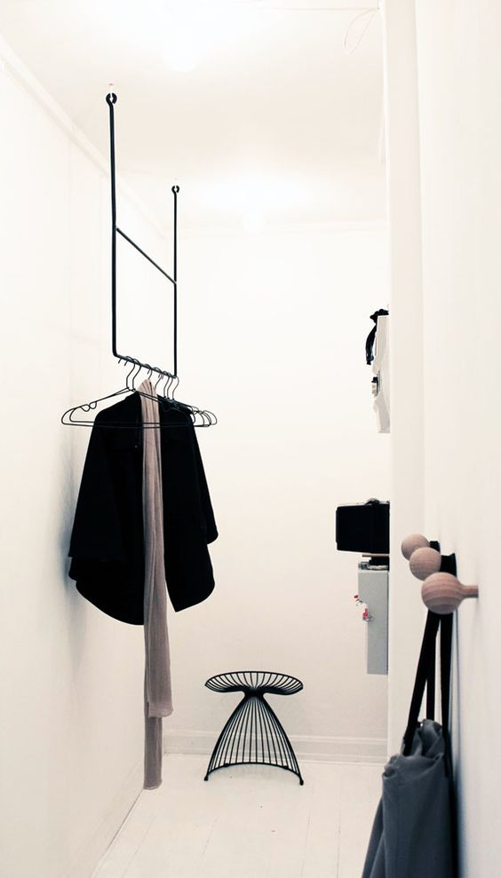 minimal steel rack hanging from the ceiling
