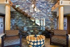 26 rough stone floor adds to the warm rustic cabin look of the entryway