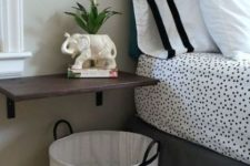27 wall-mounted bedside table and a basket underneath