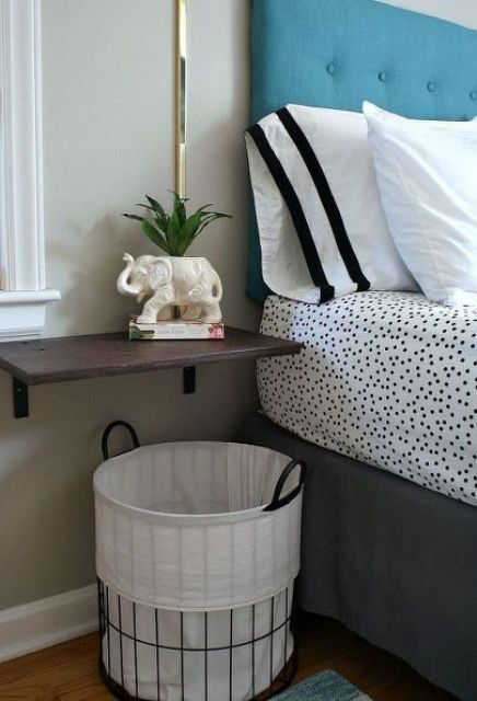 wall-mounted bedside table and a basket underneath