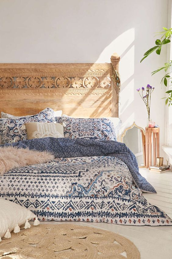 blue bedding and a jute rug
