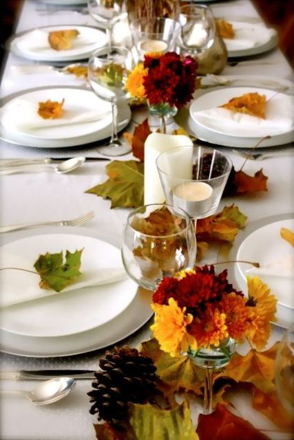 natural fall leaves, fall flowers and white procelain and candles