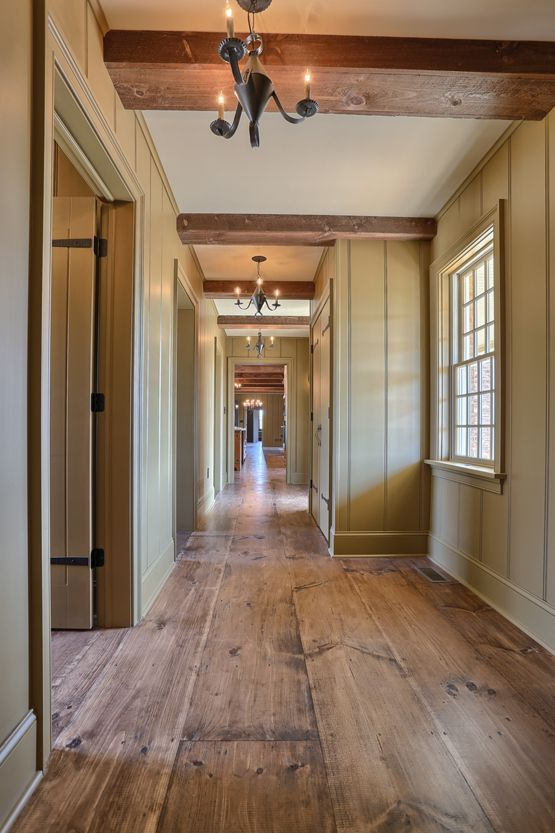 wide plank wood flooring looks cool everywhere, from an entry to a bedroom