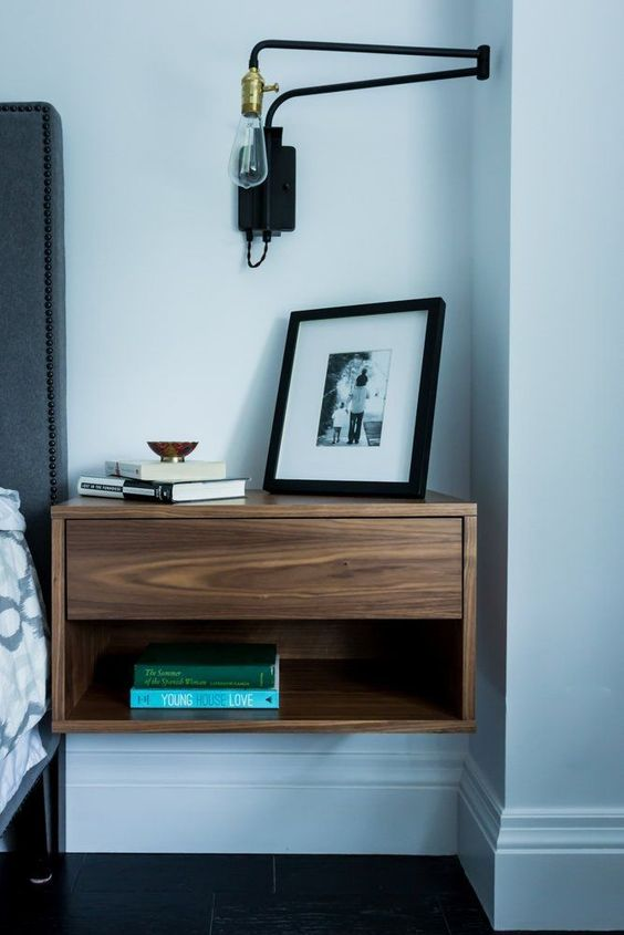 cool modern nightstand with a drawer completes the bedorom decor