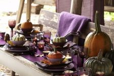 29 natural pumpkins for each place, large ones for decor, a purple table runner, fall leaves as chargers