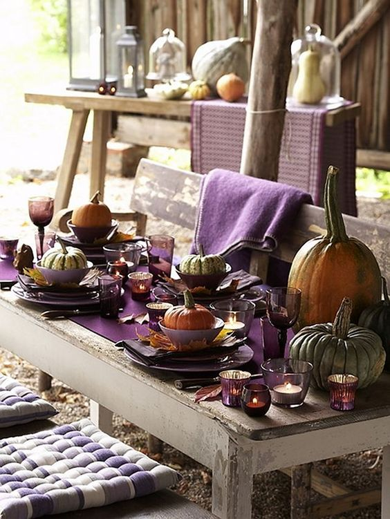 natural pumpkins for each place, large ones for decor, a purple table runner, fall leaves as chargers
