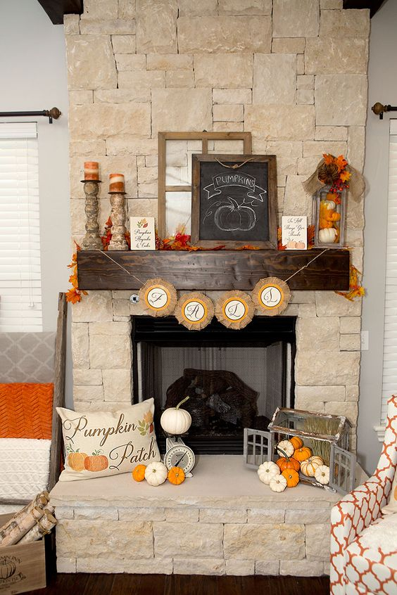 small gourds, a chalkboard and faux fall leaves, a paper bunting