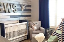 30 metallic wood wall perfectly accentuates a navy and grey nursery