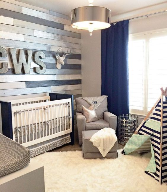 metallic wood wall perfectly accentuates a navy and grey nursery