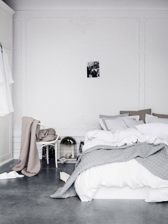grey polished concrete floor in a bedroom as it's eco friendly
