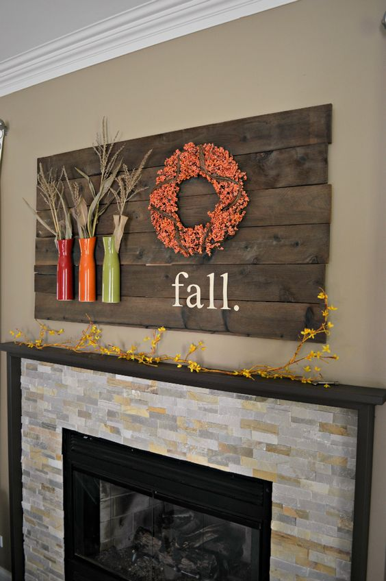 pallet board with vases and a wreath with words