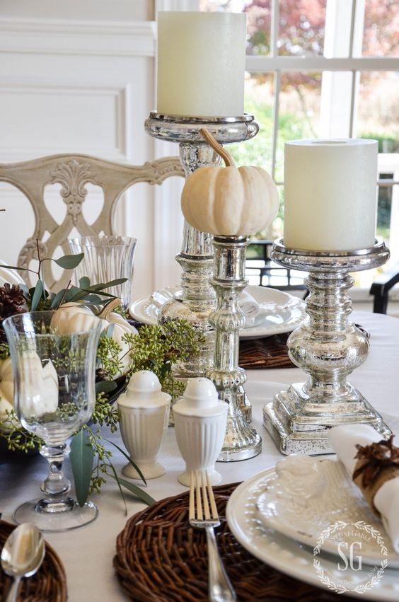 silver candle holders and pumpkin stands, woven chargers and white porcelain