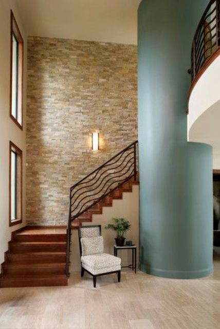 stacked stone wall in the hallway with a sea-inspired pillar