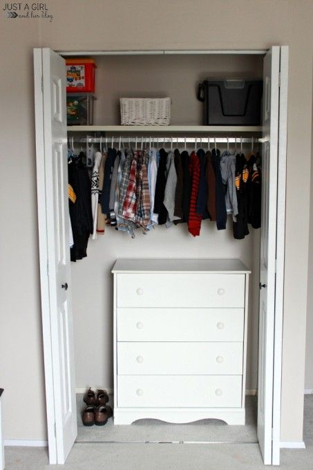 in-wall closet with holders and a sideboard for smaller things